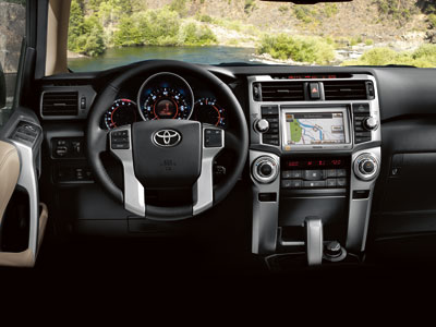 Limited 4x4 shown in Sand Beige leather with available voice-activated touch-screen DVD navigation system.