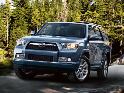 Limited 4x4 shown in Shoreline Blue Pearl with available accessory roof rail cross bars.